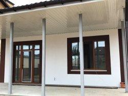Дом в Ворзеле, в окружении новых построек.